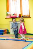 Two kids in Montessori preschool Class. Stock Image