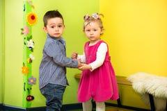 Two kids in Montessori preschool Class. Little girl and boy playing in kindergarten Royalty Free Stock Photo