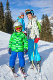 Two kids with mother enjoying winter vacations. Royalty Free Stock Images