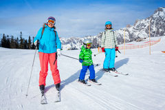 Two kids with mother enjoying winter vacations. Stock Photo