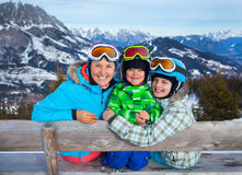 Two kids with mother enjoying winter vacations. Stock Photos