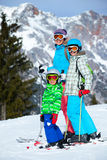 Two kids with mother enjoying winter vacations. Royalty Free Stock Photography