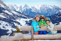 Two kids with mother enjoying winter vacations. Royalty Free Stock Image