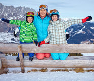Two kids with mother enjoying winter vacations. Stock Photography