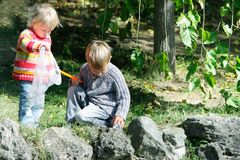 Two kids on nature Stock Image