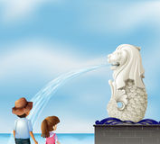 Two kids near the statue of Merlion Royalty Free Stock Images