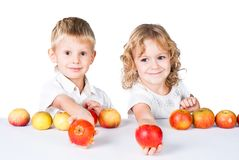 Two kids offering apples on white stock photo
