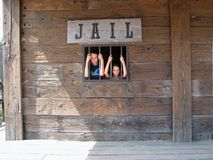 Two kids in old jail royalty free stock image