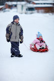 Two kids outdoors on winter day Stock Photo