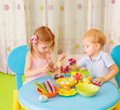 Two kids painted Easter eggs Royalty Free Stock Photo