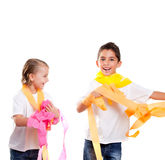 Two kids in party with colorful paper ribbon Stock Images