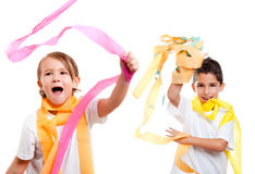 Two kids in party with colorful paper ribbon Stock Photography