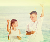 Two kids planes beach Royalty Free Stock Photography