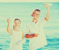 Two kids planes beach Royalty Free Stock Photos