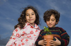 Two kids plant pot Stock Image