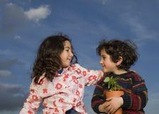 Two kids plant pot Stock Photo