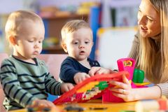 Two kids play role game in toy shop at home or kindergarten royalty free stock image