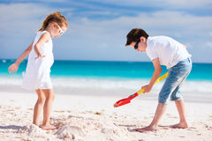 Two kids playing at beach Stock Images