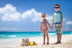 Two kids playing at beach Stock Photos