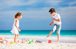 Two kids playing at beach Stock Image