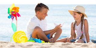 Two kids playing beach Stock Image
