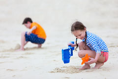 Two kids playing at beach Stock Photography