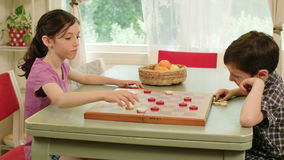 Two kids playing checkers stock footage