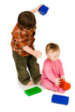 Two kids playing colorfull blocks Royalty Free Stock Photo