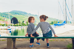 Two kids playing outdoors Stock Photos