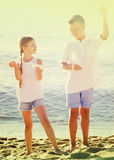 Two kids playing paper planes Stock Images
