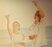 Two kids playing paper planes Royalty Free Stock Photography