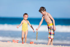 Two kids playing with sand Royalty Free Stock Photography