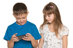 Two kids plaing with smartphone Royalty Free Stock Photo