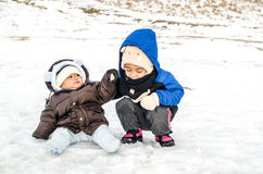 Two kids playing snow Royalty Free Stock Photo
