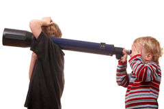 Kids with telescope Royalty Free Stock Photography