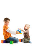 Two kids playing together Stock Images