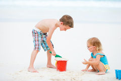Two kids playing together at beach Royalty Free Stock Photography