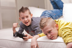 Two kids playing video games Royalty Free Stock Photo