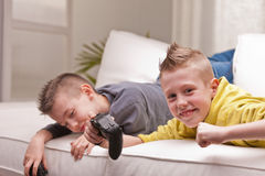 Two kids playing video games Stock Photo