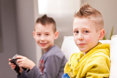 Two kids playing video games Royalty Free Stock Image