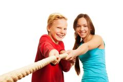 Two kids pulling the rope stock photography