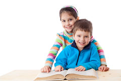 Two kids reading the book Stock Photography
