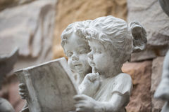 Two kids reading a book Royalty Free Stock Photos