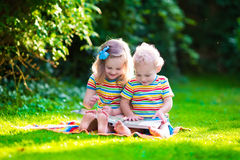 Free Two Kids Reading In Summer Garden Royalty Free Stock Photo - 57179305
