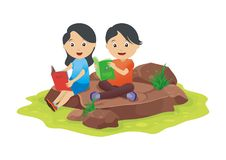 Two kids reading outdoors Stock Image