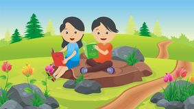 Two kids reading outdoors Stock Photo