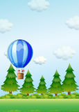 Two kids riding in an air balloon Royalty Free Stock Image