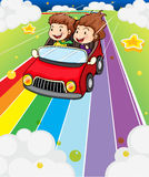Two kids riding in a red car stock photo