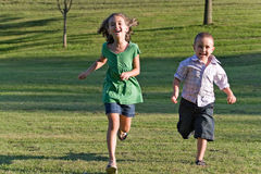 Two Kids Running stock images