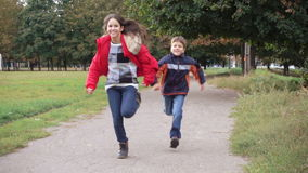 Two kids running on park. Two happy kids running on park, slow motion 100 fps stock footage